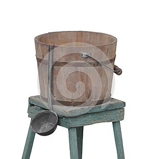 Old water bucket and dipper isolated.