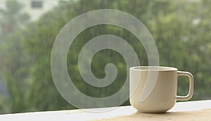 Coffee cup on a rainy day