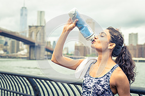 Thirsty athlete drinking after long run in New york city