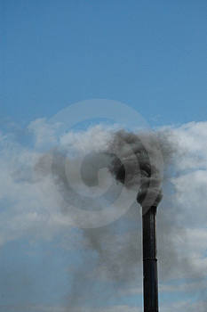 Smoke rising from tall chimney