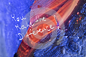 Words You make the difference! handwritten on red burn wooden background