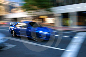 Speeding blue car