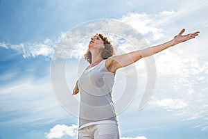 Zen middle aged yoga woman opening up her chakra