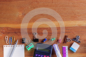 School or Office Supplies on Top of Wooden Table. Captured at Bottom Border Frame