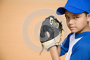 Boy preparing to pitch baseball