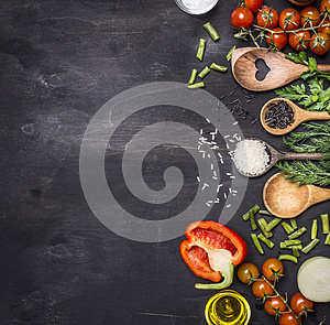 Healthy foods, cooking and vegetarian concept cherry tomatoes, wild rice, spices, salt border ,place text on wooden rustic b