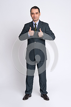 Businessman making the thumbs up gesture