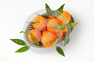 Scuttle of ripe tangerines