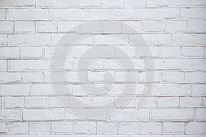 Abstract weathered texture stained old stucco light gray and aged paint white brick wall background in rural room