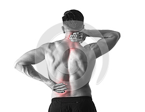Back view of young man with muscular body holding his neck and low back suffering spinal pain