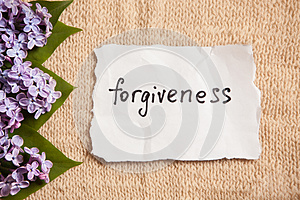 Forgiveness concept on beautiful background with flowers