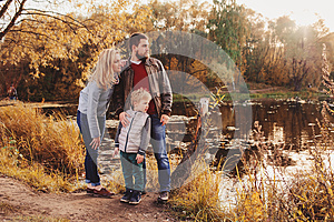 Happy family spending time together outdoor. Lifestyle capture, rural cozy scene