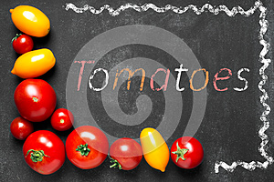 Juicy tomatoes on the black chalkboard