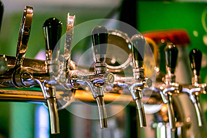 Beer taps in a pub.
