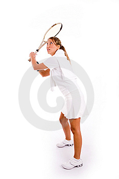 Front view of young woman playing tennis