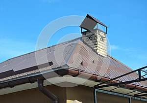 Closeup on new house rain gutter system and roof protection from snow board on house roofing