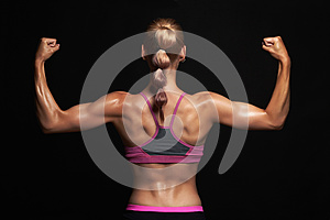 Back of athletic girl. gym concept. muscular fitness woman, trained female body