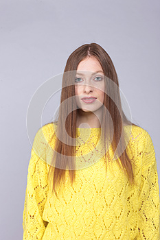 Attactive red haired woman with yellow pullover