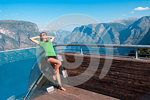 Woman enjoying scenics from Stegastein Viewpoint