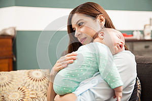 Cute woman enjoying motherhood