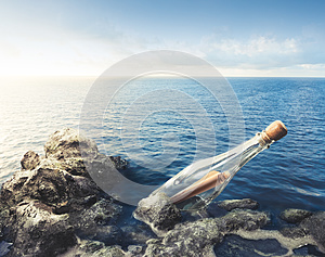 Glass bottle with message at sea