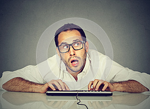 Man typing on keyboard wondering about reply