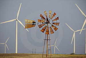 Wind turbines surround windmill