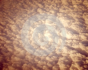 Bed of White Clouds in Sky captured from Air with Sepia Effect