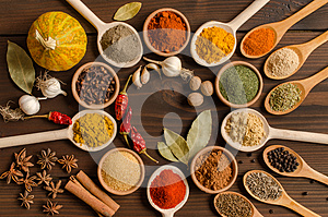 Set of Indian spices on wooden table - Top view