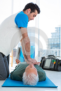 Paramedic performing resuscitation on the patient