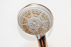 Dirty shower head with limescale and rust on it