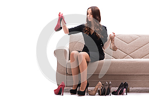 The woman having difficult choice between shoes