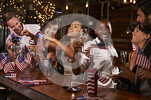 Friends celebrating July 4th at a party in a bar