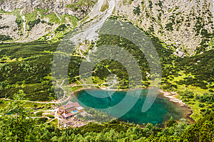 Slovakian Tatras. Mountain valley with green pond and the tourist chalet.