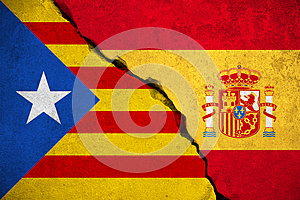 Spain flag on broken brick wall and half catalan flag, vote referendum for catalonia independence exit national crisis separatism