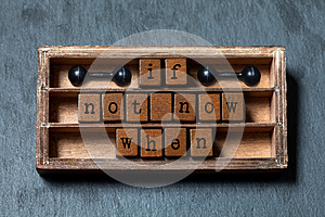 If not now when. Motivation and success future management quote. Vintage box, wooden cubes with old style letters