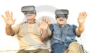 Senior retired couple having fun together with virtual reality glasses