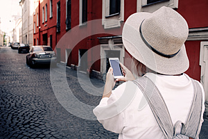 Tourist using navigation app on the mobile phone. Travel concept