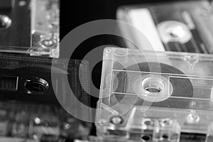 A stack of old audio cassettes. Black and White