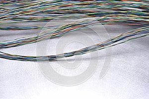 Electrical cable on grey metal background