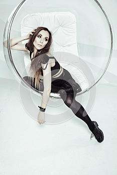 A photo of beautiful woman is in fashion style, Esquire style, glamur. Woman in the studio. Lady in black posing on the