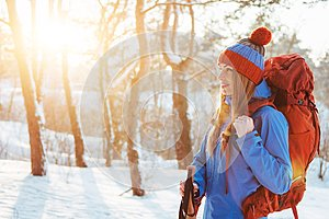 Woman Traveler with backpack hiking Travel Lifestyle adventure concept active vacations outdoor. Beautiful landscape forest