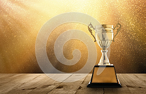 champion golden trophy on wood table with copy space and gold Twinkly Lights and glitter stars light background copy space ready