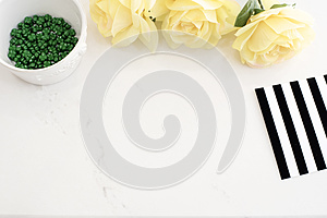 Light Marble Stylish Desktop With Yellow Roses, Black White Stripe design. Header website or Hero website, Top view . Empty place,