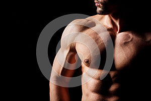 Fitness concept. Muscular and torso of young man having perfect abs, bicep and chest. Male hunk with athletic body.