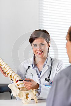 Female Orthopaedic surgeon explaining a back injury