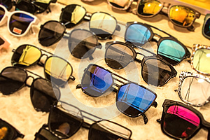 Sunglasses in many dark UV shades for different styles. Shopping for discounts and sales at eyeglass market shop. Get your discoun