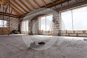 Interior of apartment  during under renovation, remodeling and construction a pair of working shoes on the cement floor