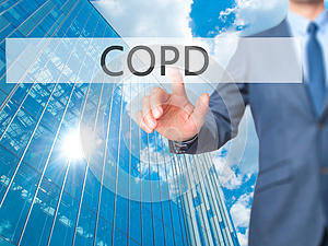 COPD - Businessman hand touch button on virtual screen interfa