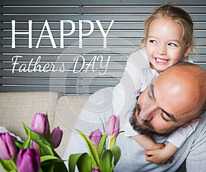 Happy father`s day concept, father and daughter having fun and smiling